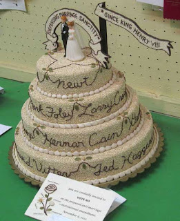 Elaborate wedding cake covered in white millet with brown script writing on each layer