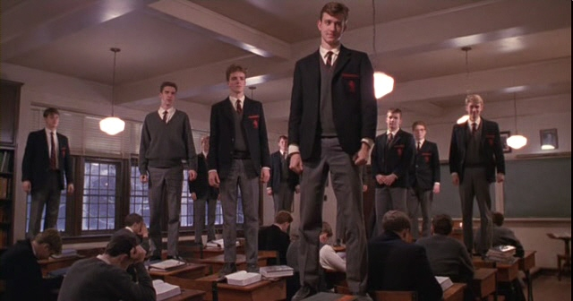 dead poets society standing on desks to make change