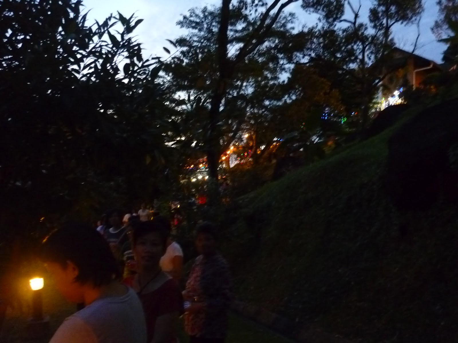 devotees n patrons lining the pathway waiting for the signal to start the giving of light ceremony