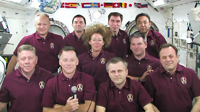 Atlantis – STS135 – Spacewalk on day 5. Astronauts get together at ISS for a conference with the president of USA. NASA-TV 2011.