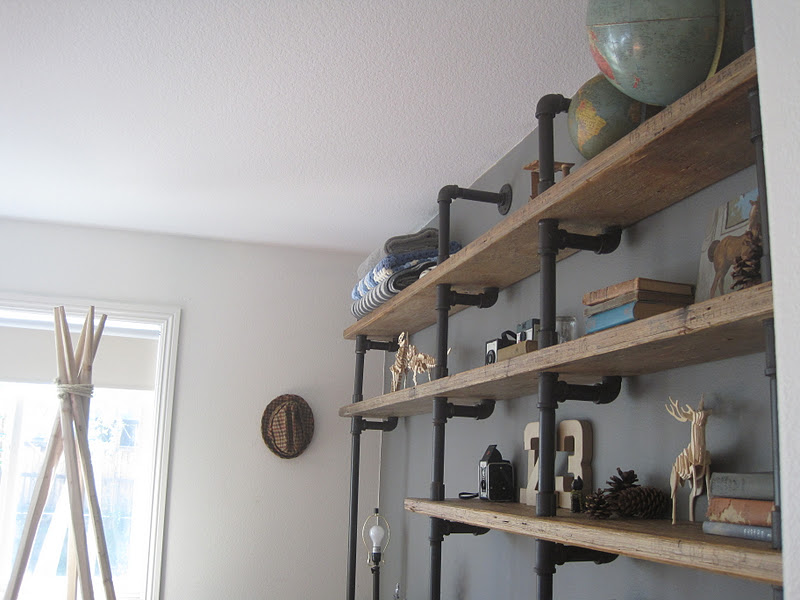 House of habit home works pipe shelf unit in boy 39 s room - Etagere murale pour bibliotheque ...