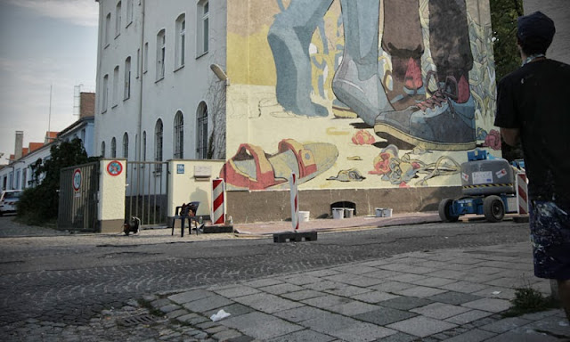 Street Art By Spanish Artist Aryz For Positive Propaganda In Munich, Germany. 7