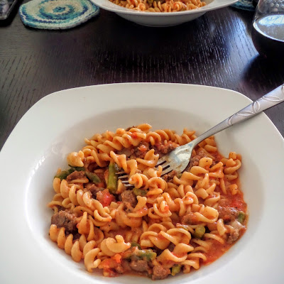 Turkey and Asparagus Skillet Pasta:  A one dish meal of turkey Italian sausage and asparagus, with pasta in tomato sauce, plus cheese all cooked in only one skillet.