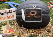 I thought this one was the most clever by far. A pumpkin Weber grill with .
