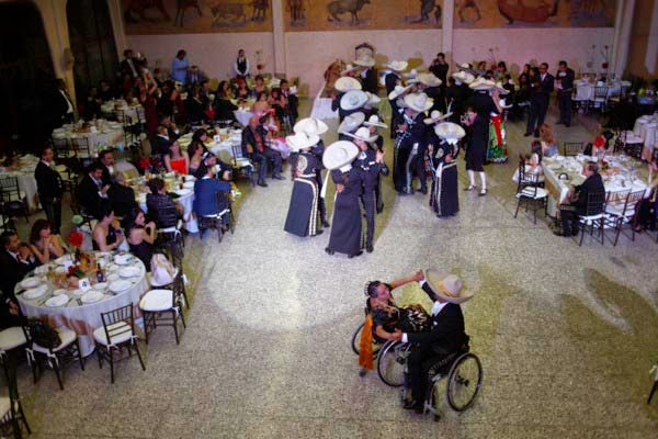 charrs dance in their wheelchairs at the crowning ceremony for Samantha Mayorga Catillo at la villa charreria association in mexico city