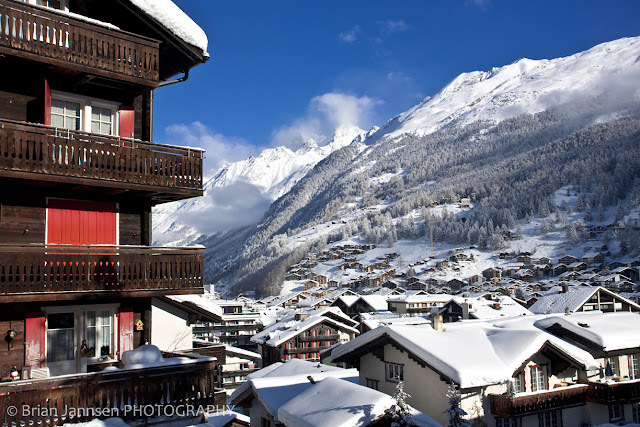 Sweeping views of the Zermatt village lying beneath the mountain majesty of the Swiss Alps.