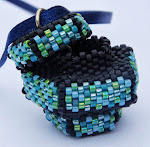 beaded hollow pendent with lid