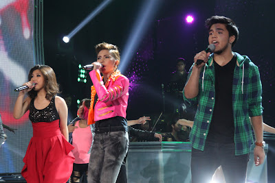 Allen Sta. Maria, Yeng Constantino and Jeric Medina during a production number in the X Factor PH results night
