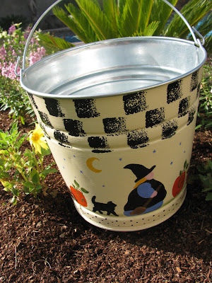 Halloween bucket with witch, cat, pumpkins