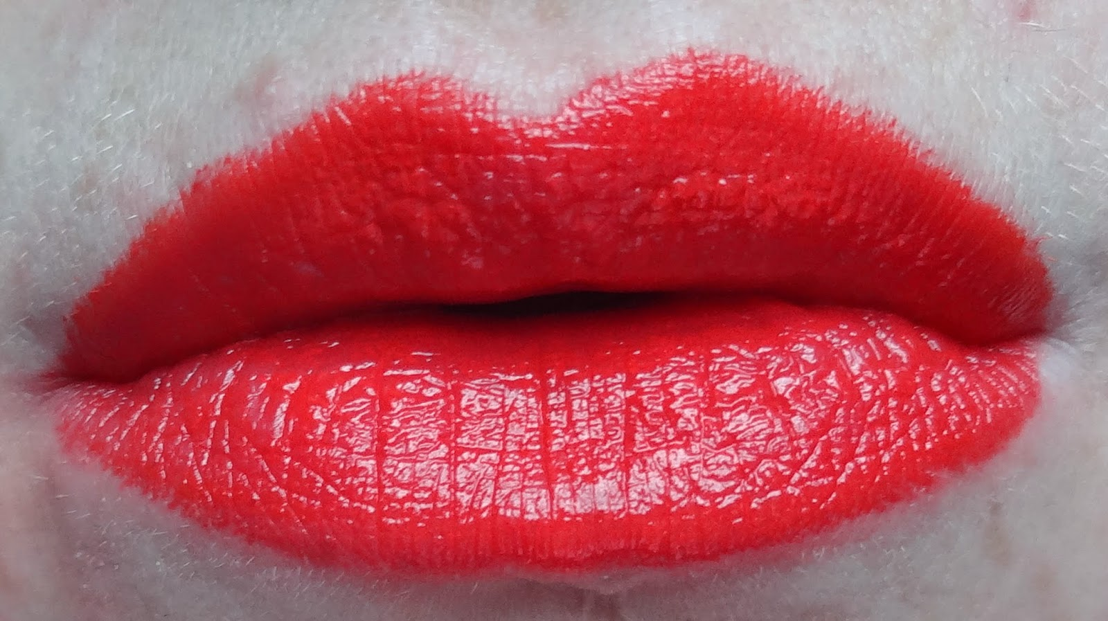 Rimmel In love with ginger orange lip swatch