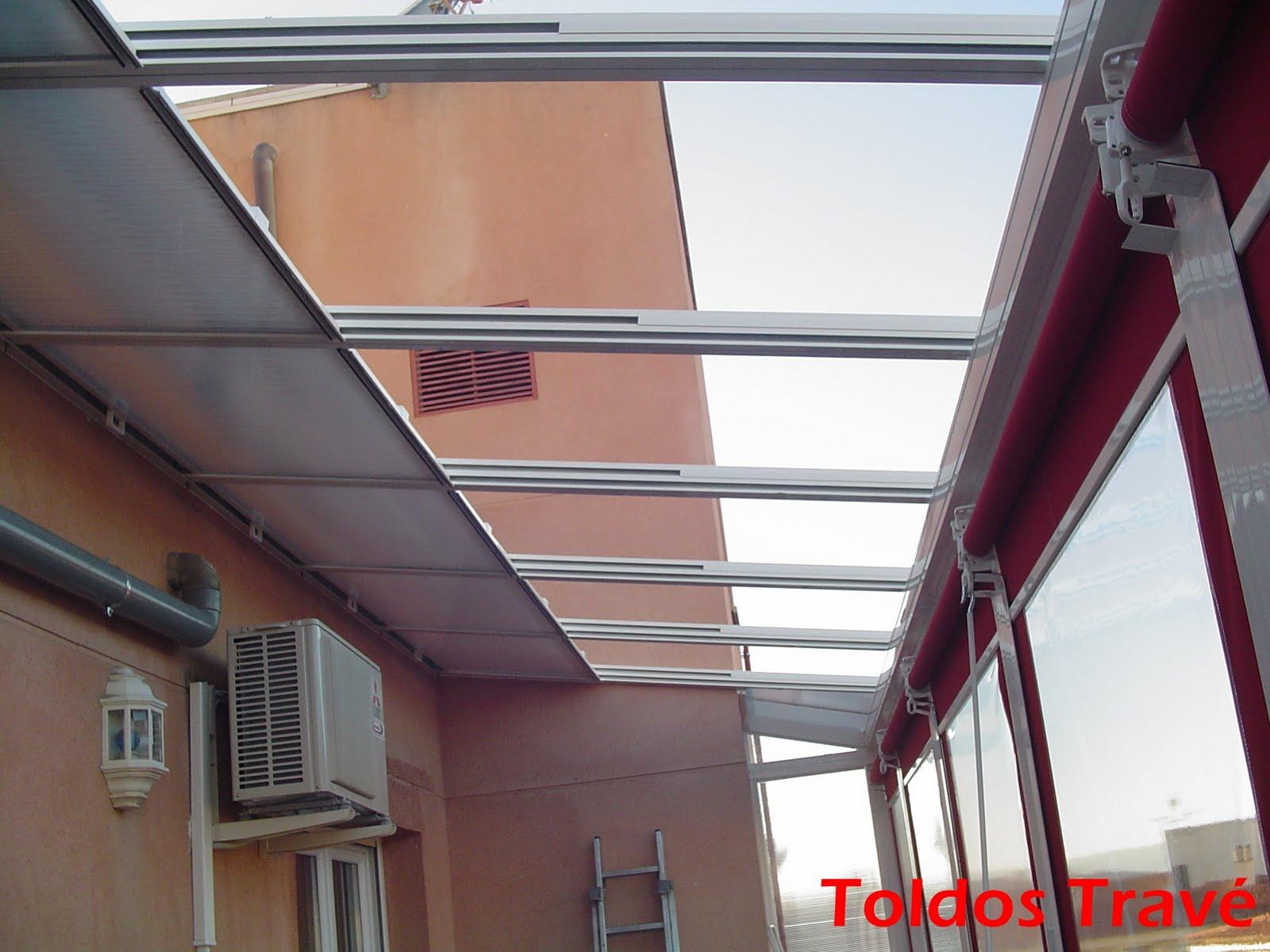 Toldos trav cerramientos ticos for Toldo terraza atico