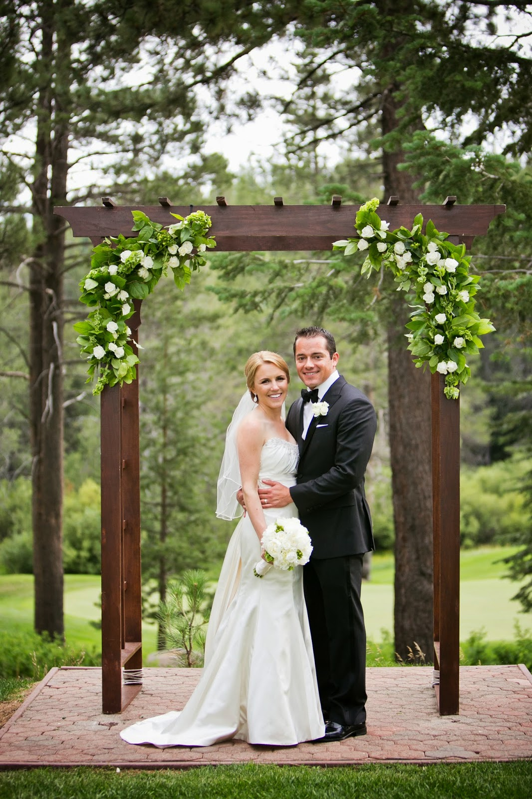 Ceremony Arch decorated by Tahoe Blooms // Kacie Jean Photography // Take the Cake Event Planning