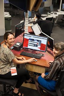 Librarians sitting at desk
