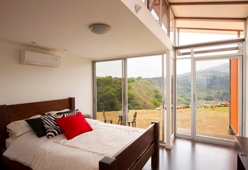 12-Master-Bedroom-Recycled-Container-House-Architect-Benjamin-Garcia-San-Jose-Costa-Rica-Solar-Panels-Recycled-Metal-www-designstack-co