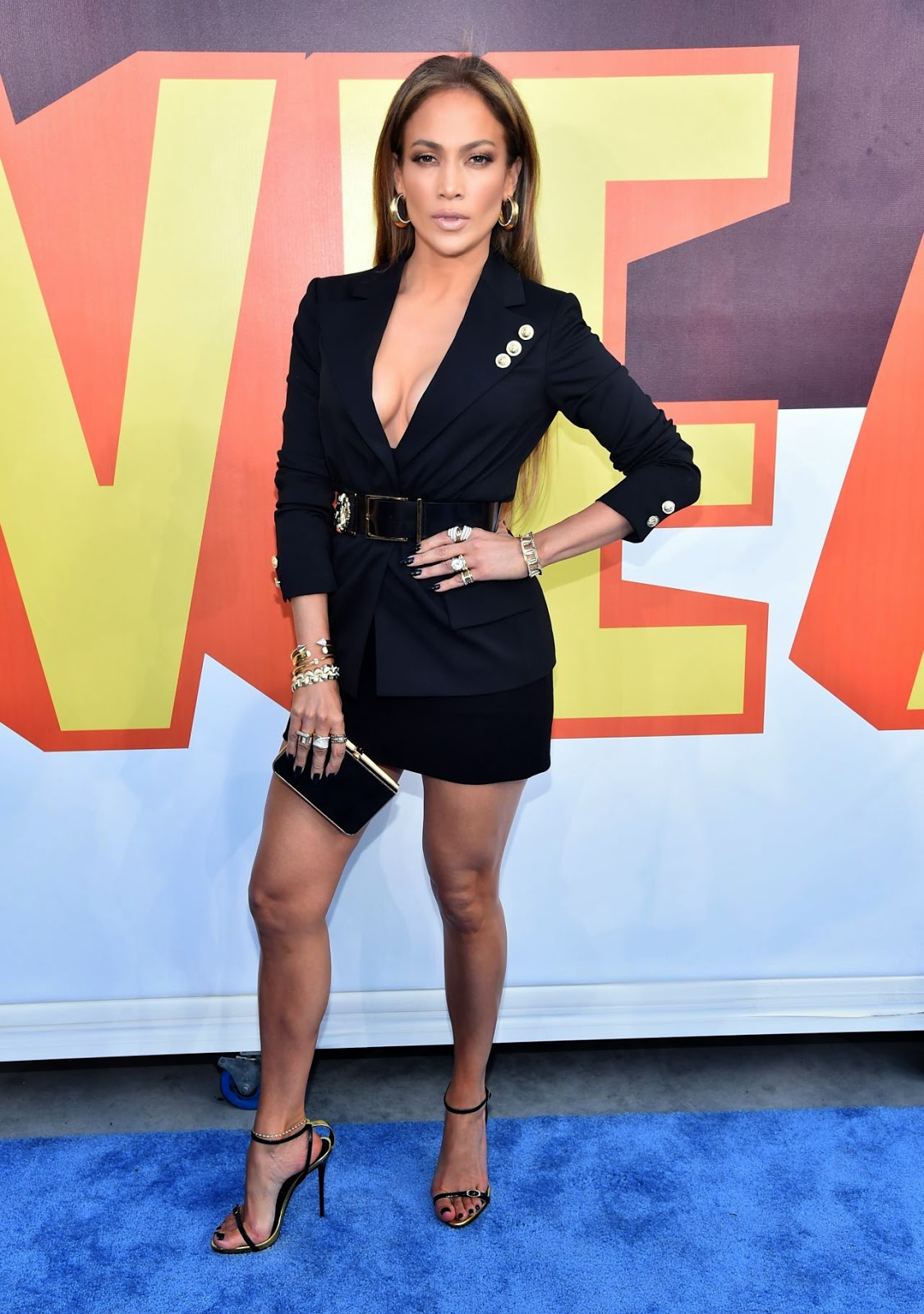 Jennifer Lopez bares cleavage in a Versus Versace mini dress at the 2015 MTV Movie Awards