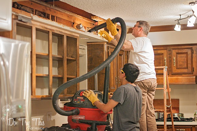 Do Try This at Home: removing cabinets over the sink, vacuuming out the light fixture