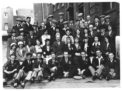 Black and white photo, Simmons Co staff, outside No1 Tanner Street, Bermondsey, London SE1. Photographer unknown.