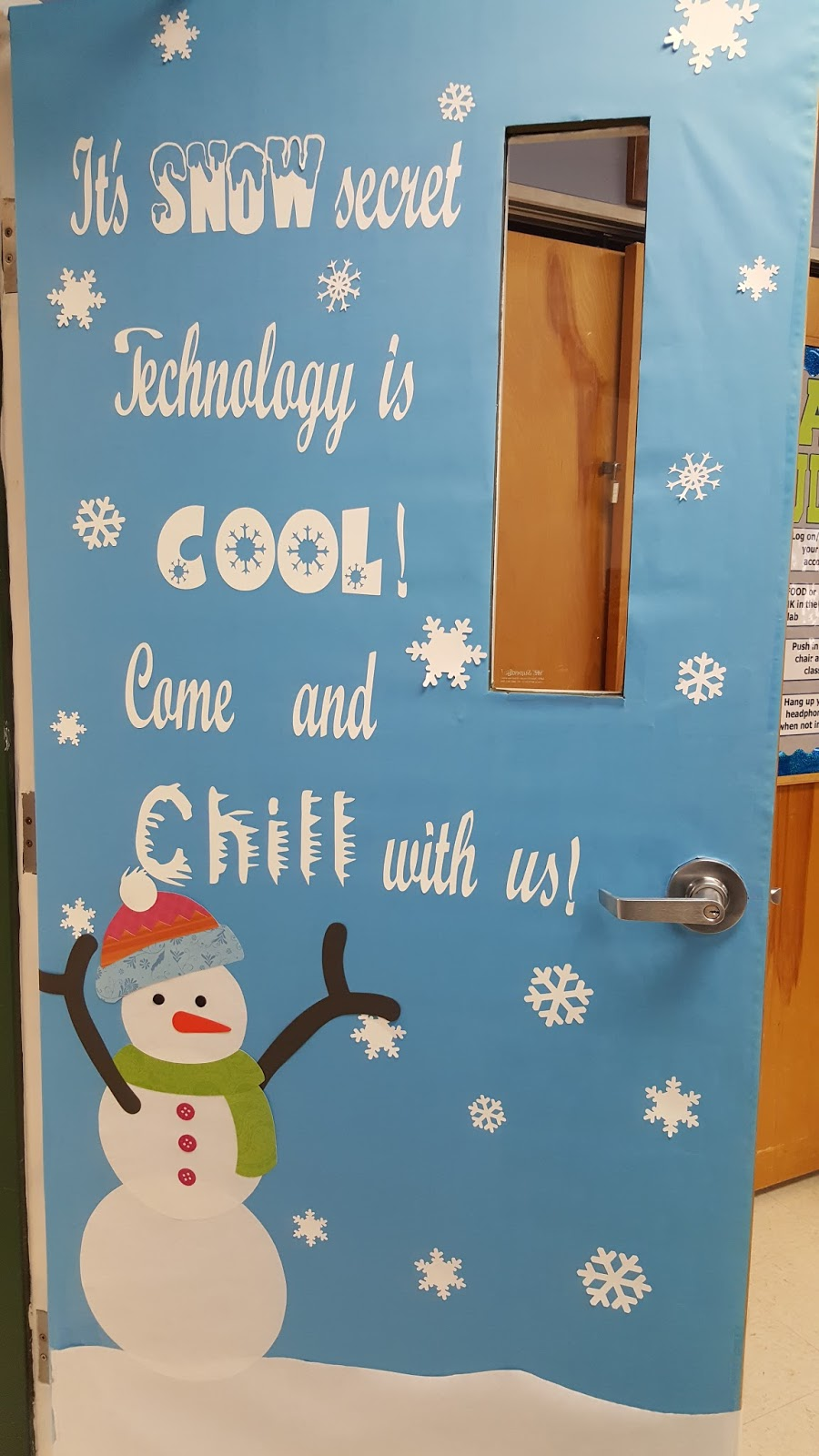A techy teacher with a cricut winter snowman themed Class door winter decorations