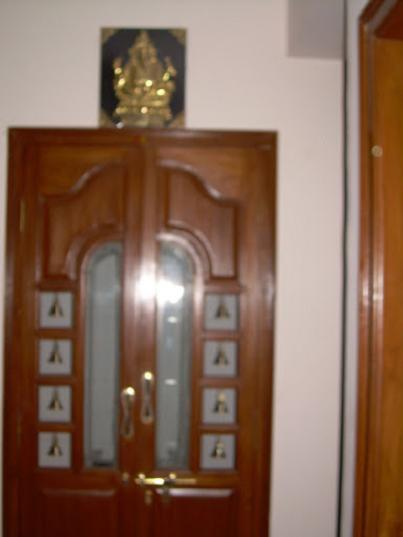 Carpenter work ideas and kerala style wooden decor pooja - Pooja room door designs in kerala ...