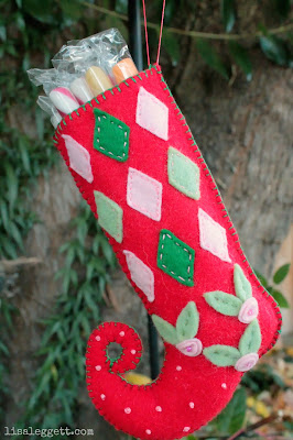 Felt, hand stitched stocking by Lisa Leggett