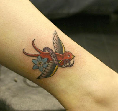 flying small bird tattoo