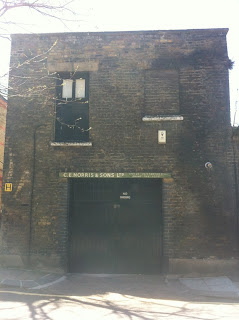 Old sign on a garage in Whidbourne Street, King's Cross, London, WC1