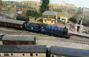 I JUST LOVE MY TRAINS AND MODELS.