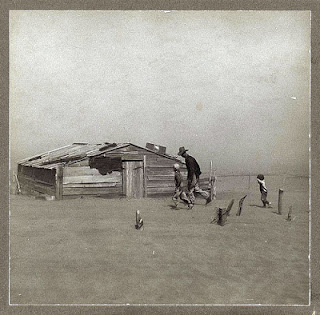 Kansas Oklahoma Dust Bowl Great Depression Father walking with children before dust storm old dug out house