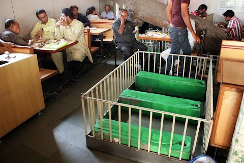 Photos: Bizarre Cemetery Restaurant where Customers Sit with DEAD People