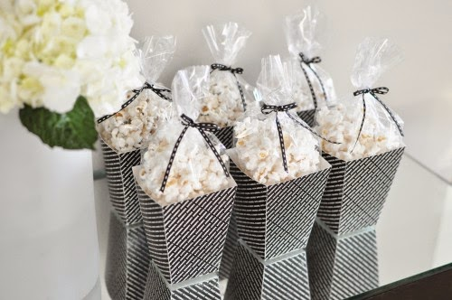Popcorn Bar ideas for an Oscars/Academy Awards viewing party; bagged popcorn in boxes