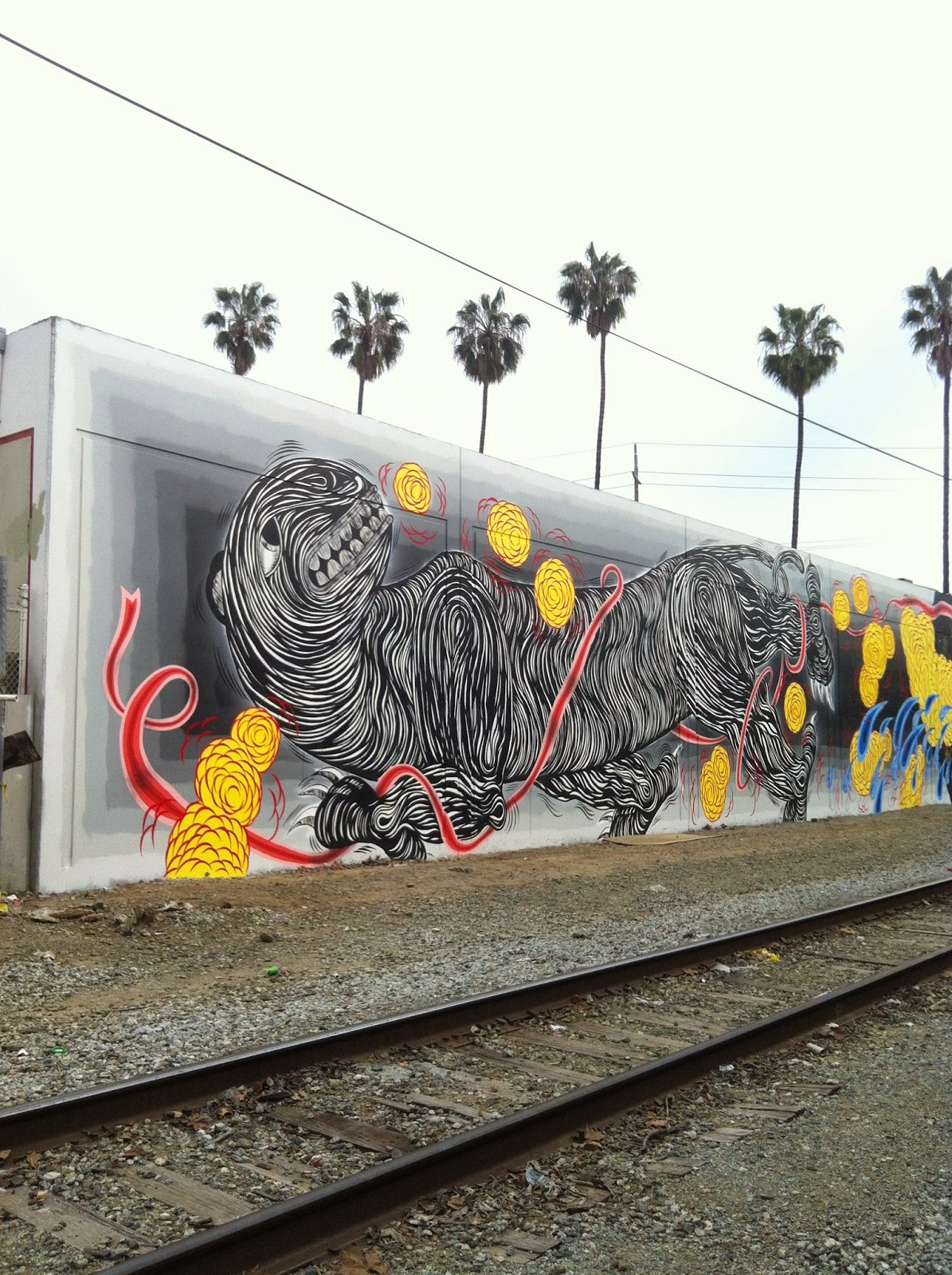 Andrew Schoultz is currently in Santa Fe, California where he just finished working on this beasty mural.