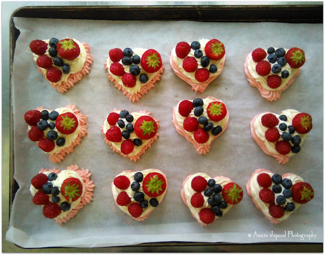 Mini Heart Shaped Pavlovas topped with fresh berries and cream