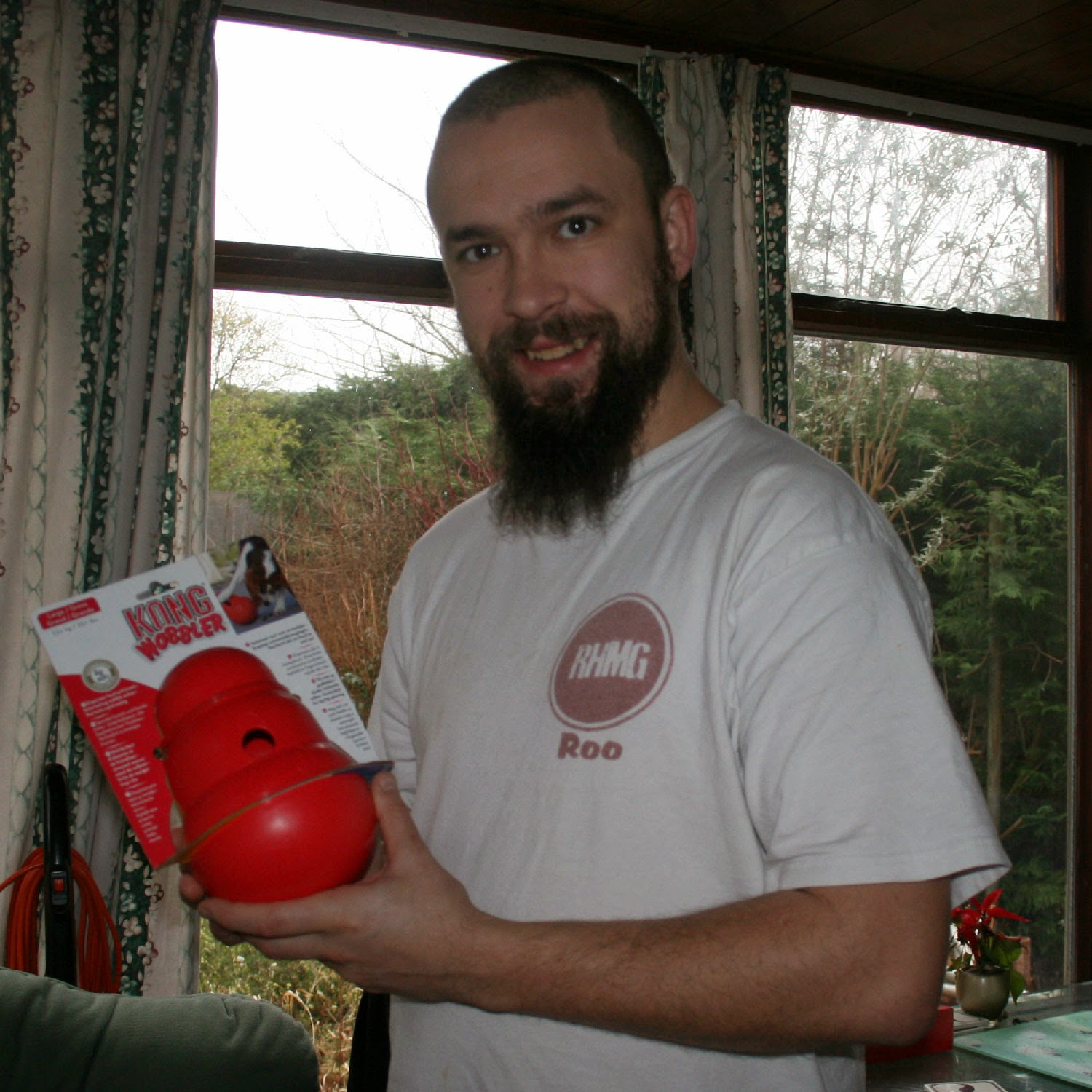 The Kong Wobbler, bright red and huge