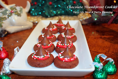 Easy Life Meal & Party Planning - Holiday Chocolate Thumbprint Cookies are doubly delightful with Hershey Kisses inside a chocolate cookie with creamy buttery frosting