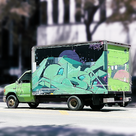 Moving street art mural on truck sides.