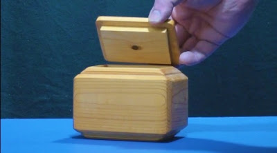 Removing the rectangular lid from wooden jewel shaped tea box