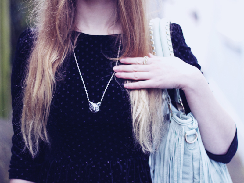 wolf necklace, topshop black sparkly dress, brand village blue fringed bag, orelia stackable rings