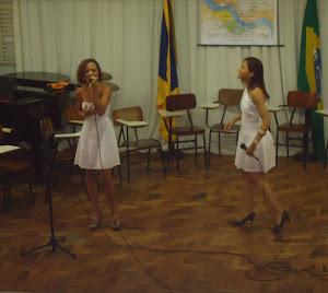 Gleide  Lelis  (voz)  e  Ana  Paula Oliveira  (voz)