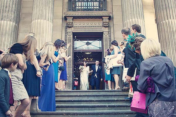 guests throwing confetti at Marylebone Town Hall wedding