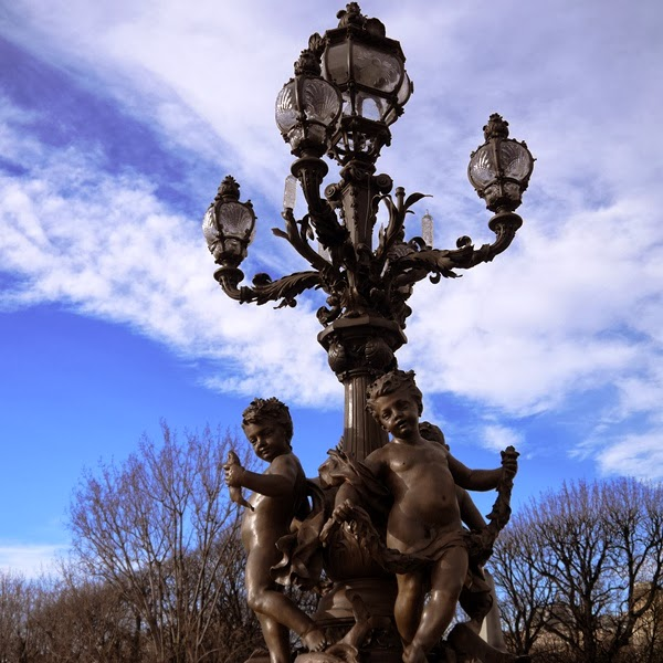 Decorative cherub lamp on Pont de la Concorde in Paris