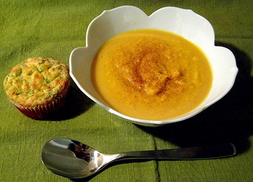 Bowl of soup with nutmeg and muffin