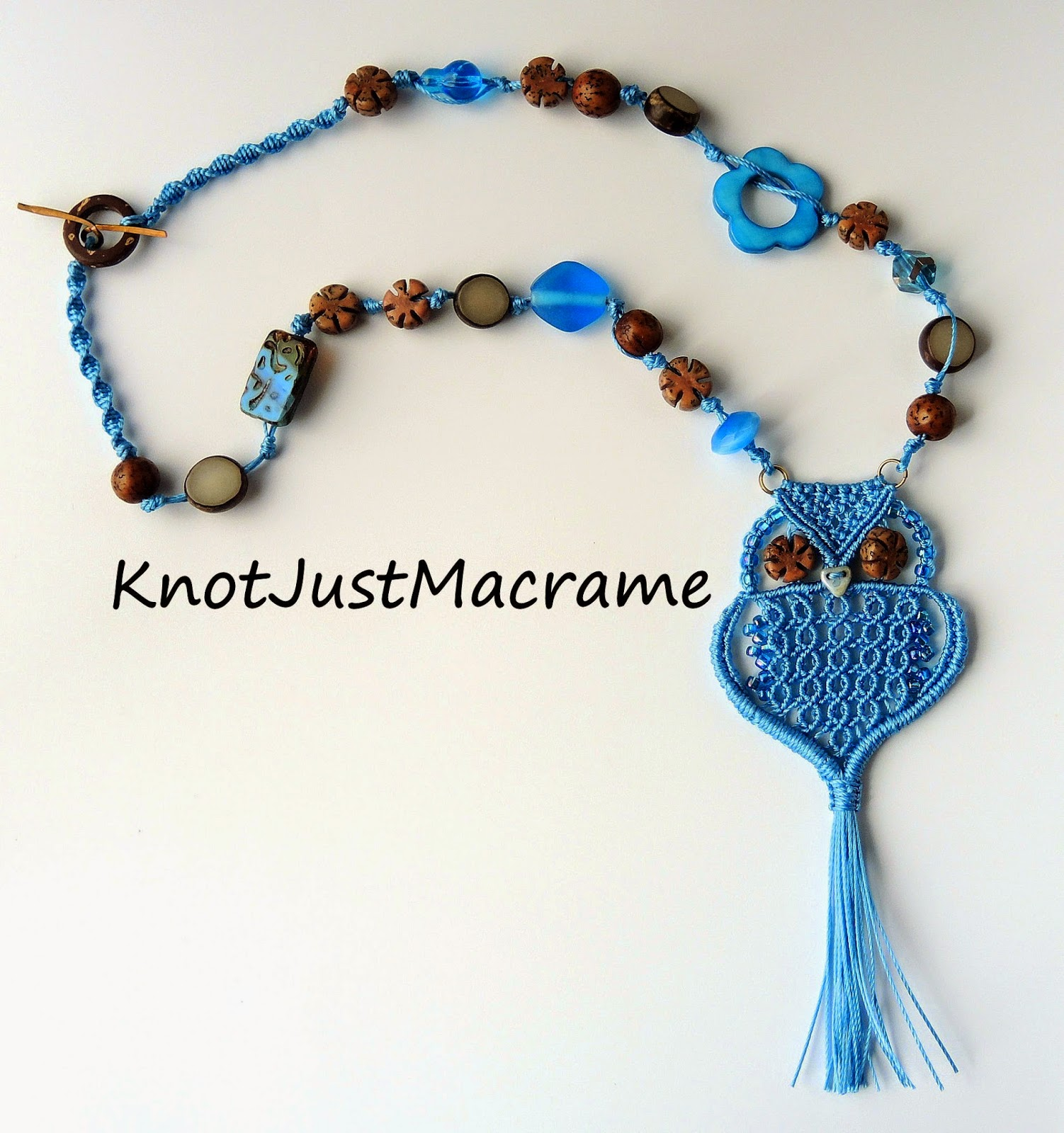 Micro macrame owl pendant with salwag seed, buri seed, and glass beads.