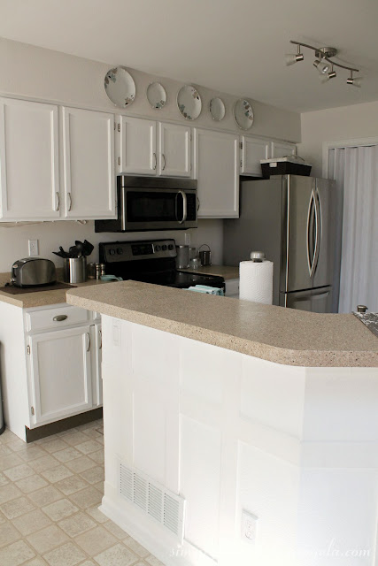 Simply beautiful by angela repainting the kitchen for Can kitchen cabinets be repainted