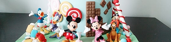 Header picture of candy land cake with mickey, frozen and hello kitty