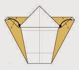 Bước 7: Gấp chéo hai góc của tờ giấy vào.