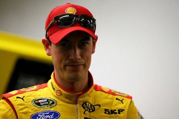 Joey Logano, driver of the #22 Shell Pennzoil Ford, stands in the garage area during practice for the NASCAR Sprint Cup Series 3rd Annual Sprint Unlimited at Daytona International Speedway on February 13, 2015 in Daytona Beach, Florida. (February 12, 2015 - Source: Maddie Meyer/Getty Images North America)
