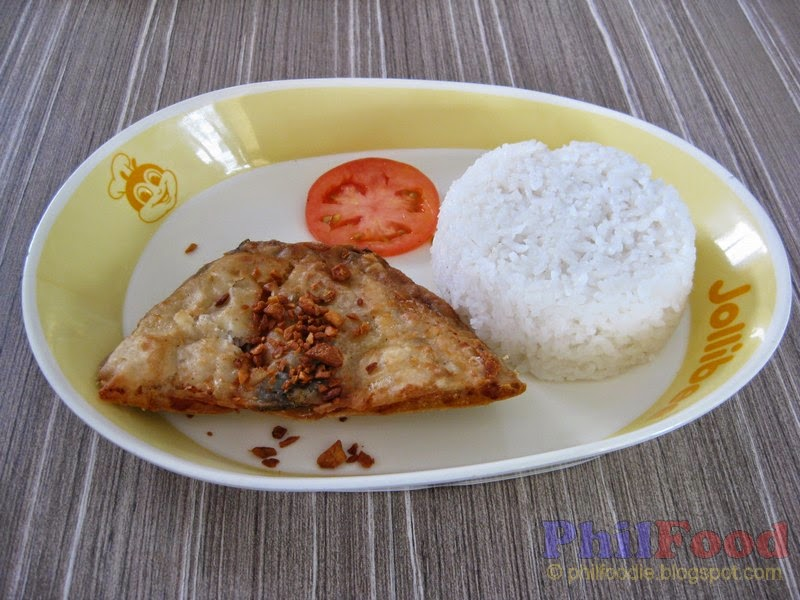 Marinated fried boneless bangus belly served with garlic bits slice of tomato and rice at Jollibee