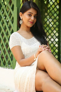 Yamini Bhaskar in Mini Dress Spicy Pics at Kothaga Maa Prayanam Movie Opening