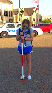 A participant maps out a mock accident scene.