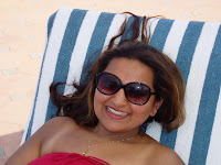 large sunglasses on sunlounger on a beach in Kerala